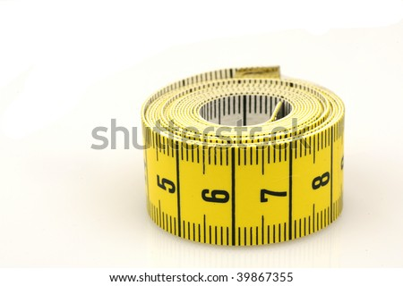 curled up tape measure on a white background - stock photo