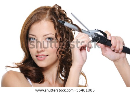 curling female brunette hair with roller - beautiful woman portrait - stock photo