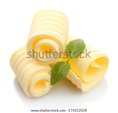 Curls of fresh butter with basil, isolated on white - stock photo