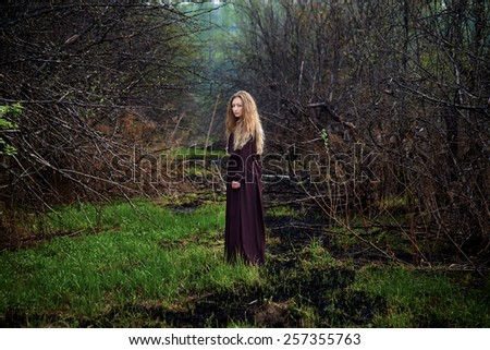 Curly blond young woman in nature