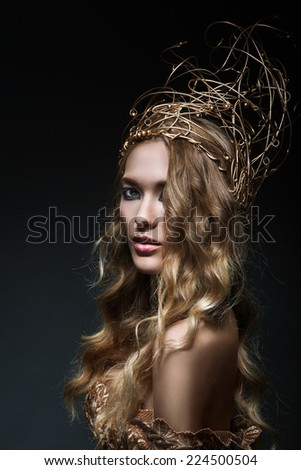 Curly blonde in gold crown (black background) - stock photo