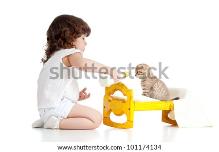 curly child girl playing with kitten as mother with baby - stock photo