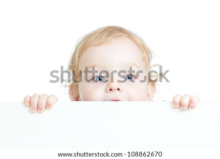 Curly cute child holding blank advertising banner - stock photo