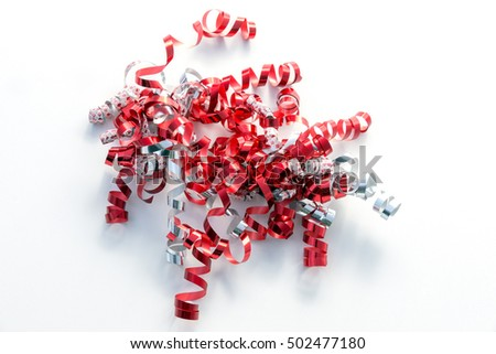 Curly gift ribbons in red, silver, white and patterned diamonds