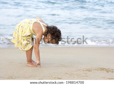 Curly girl near the sea
