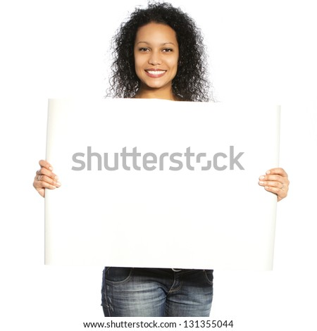 Curly hair female holding white blank banner isolated on - stock photo