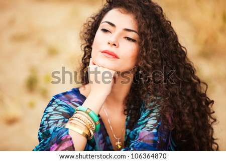 curly hair woman portrait outdoor summer day