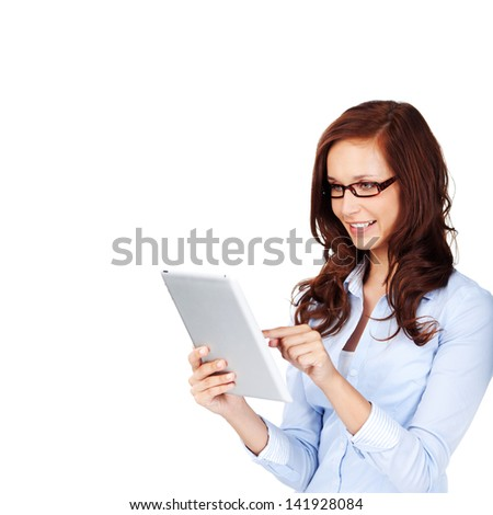 Curly hair woman with glasses browsing using her digital pad  - stock photo
