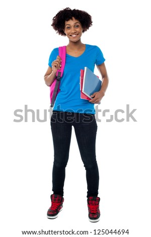 Curly haired college student isolated against white background. Full length portrait.