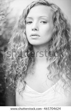 Curly haired girl in nature