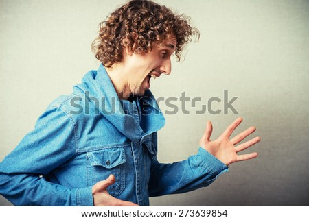 curly-haired manyelling and gesturing - stock photo