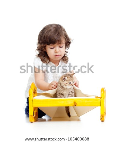 curly kid girl playing with kitten as mother with baby - stock photo