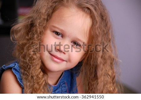 Curly little blond girl portrait smiling - stock photo