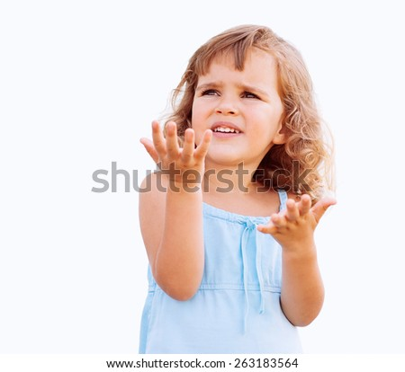 Curly little girl showing copy space - stock photo