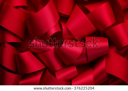 Curly red ribbon,ribbon background - stock photo
