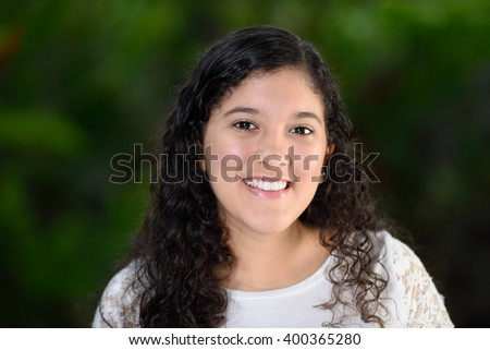Curly teen girl smiling