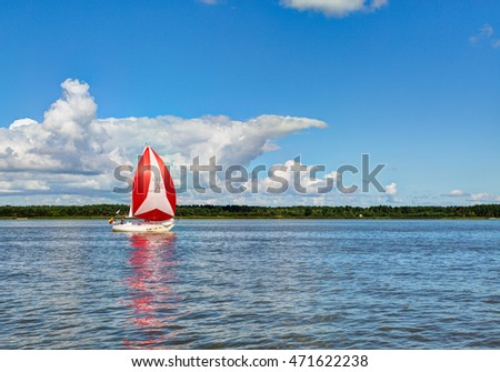 CURONIAN GULF, LITHUANIA - 03 AUGUST 2016: Colorful yachts are competing through the Curonian gulf. Lithuania.