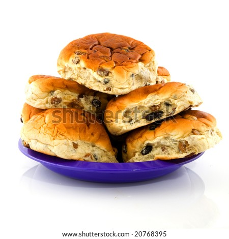 currant bread rolls stacked on a purple plate