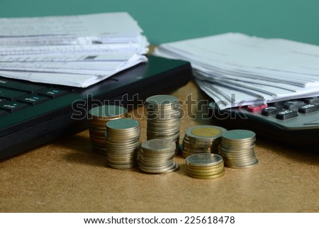 currency and receipts with laptop and calculator for financial concept  - stock photo