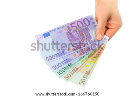 currency as the euro in a female hand on a white background