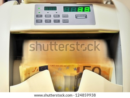 Currency counter in action, closeup - stock photo