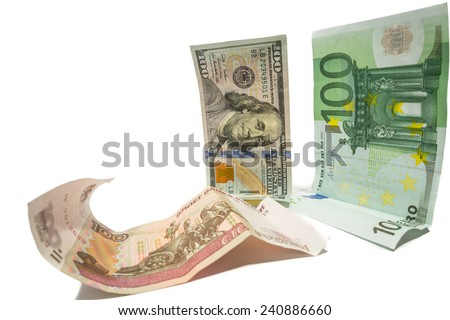 currency dollar and euro looking at fallen russian ruble - stock photo