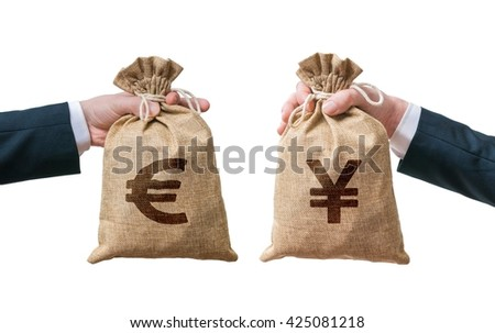 Currency exchange concept. Hands holds bags full of money - Euro and Yen. Isolated on white background. - stock photo