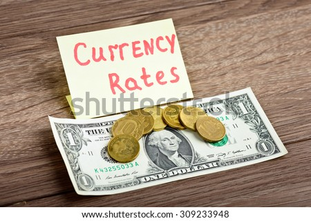 Currency exchange rates. Now 70 russian ruble per 1 american dollar - stock photo