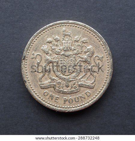 Currency of the United Kingdom 1 GBP coin over black background - stock photo