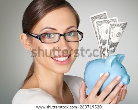 Currency. Smiling Piggybank Girl - stock photo