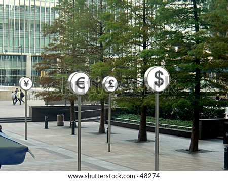 Currency Symbols shown in Canary Wharf - stock photo