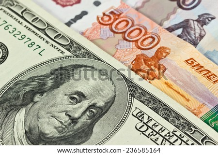 Currency: US dollars and Russian rubles - stock photo