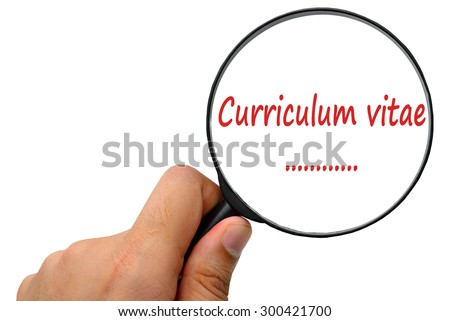 Curriculum vitae word. Magnifier and puzzles. - stock photo
