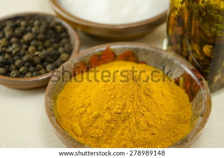 Curry pepper and olive oil on a table close up