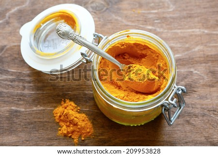 curry powder in a glass jar, food closeup - stock photo