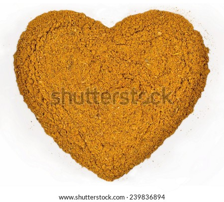Curry powder in the form of heart on a white background