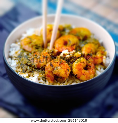 Curry prawns shrimp and rice in a bowl Caribbean food - stock photo