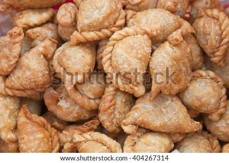 Curry puff, newly fried curry puff, snack, pastry, stuffed bread - stock photo