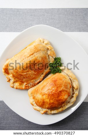 Curry Puff pastry over modern tablecloth background