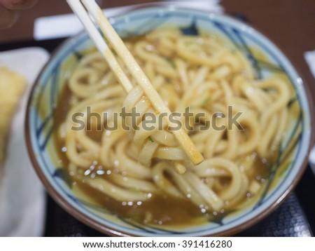 curry ramen, japanese noodle (focus noodle and chopstick) - stock photo