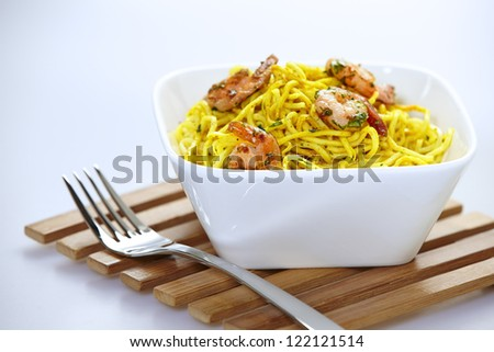 Curry shrimp noodles with curry in a bowl - stock photo