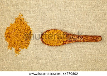 Curry spice on bamboo spoon - top view. - stock photo