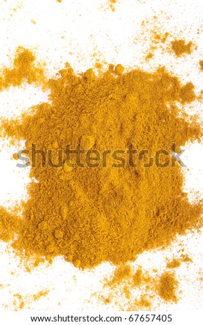 curry spice powder isolated on white background (chaotic version)