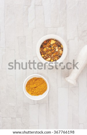 Curry spices.Curry  in and beside a mortar. Top view, blank space, vintage toned image. Natural light - stock photo