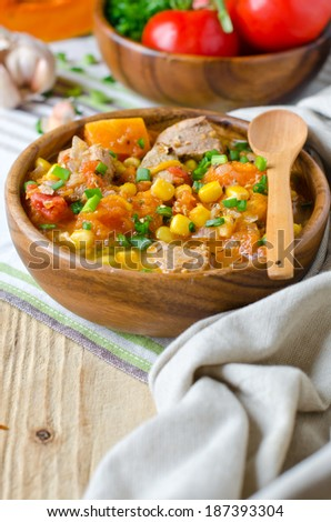 Curry with pumpkin and corn - stock photo