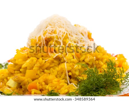 curry yellow rice with herbs on plate over white background - stock photo