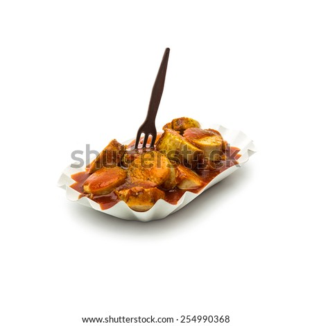 currywurst in a shell with fork isolated on white background - stock photo