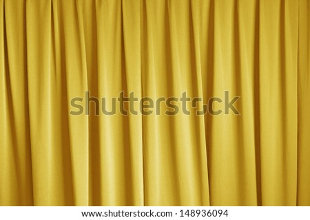 curtain of cinema stage background, yellow dramatic tone - stock photo