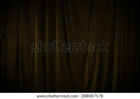 curtain or drapes dark yellow background - stock photo