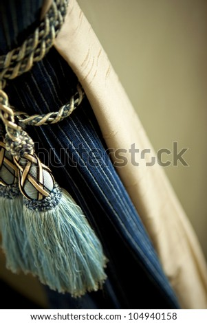Curtains and trimmings inside a house - stock photo